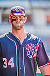 23 May 2015: Washington Nationals outfielder Bryce Harper stands in the dugout as he prepares to face the Philadelphia Phillies at Nationals Park in Washington, DC. The Phillies defeated the Nationals 8-1 in the second game of their 3-game weekend series. Mandatory Credit: Ed Wolfstein Photo *** RAW (NEF) Image File Available ***