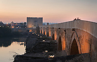 The Roman bridge in the evening, built 1st century BC over the Guadalquivir river, and the Torre de la Calahorra, a fortified city gate, built in the 12th century by the Almohads, in Cordoba, Andalusia, Southern Spain. The historic centre of Cordoba is listed as a UNESCO World Heritage Site. Picture by Manuel Cohen
