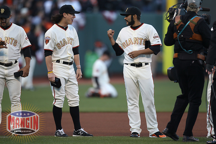 SAN FRANCISCO - APRIL 9:  Tim Lincecum #55 and Sergio Romo #54 of the San Francisco Giants stand on the field during a World Series ring ceremony before the game against the St. Louis Cardinals at AT&T Park on April 9, 2011 in San Francisco, California. (Photo by Brad Mangin)