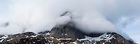 Clouds conceal steep mountain peaks, Moskenesoy, Lofoten Islands, Norway