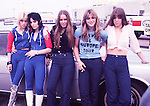 Runaways 1976 Cherie Currie, Joan Jett, Lita Ford, Sandy West and Jackie Fox at Heathrw Airport.© Chris Walter.