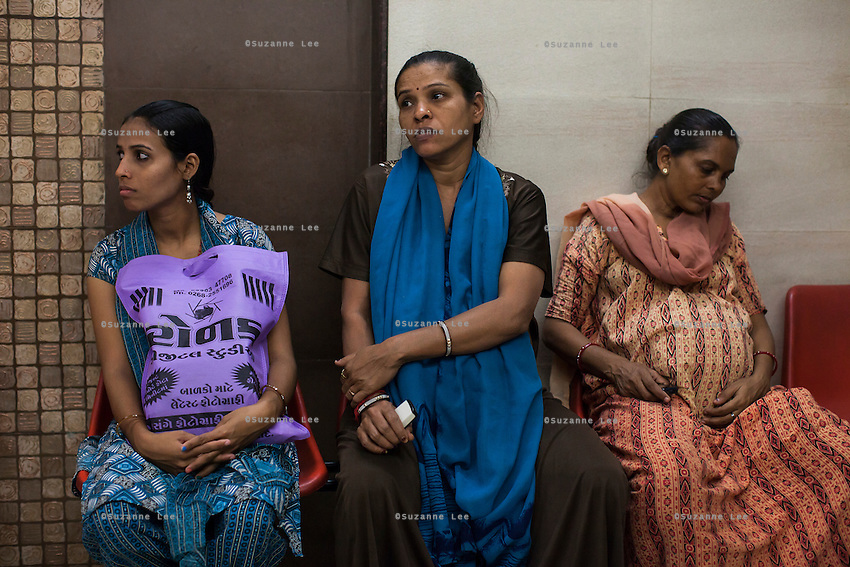 Pregnant surrogates wait for their check-ups with Dr. Nayana Patel in the Akanksha Infertility Center in Anand, Gujarat, India on 12th December 2012.  Photo by Suzanne Lee / Marie-Claire France