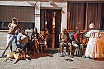 An afrouruguayan family watches performers prepare for the parade of Llamadas in the traditional black neighborhood of Barrio Sur in Montevideo.  One of the most imporant elements of Carnaval in Uruguay is Candombe, an African drum rhythm played on tambor drums.  It was revitalized in the Americas by black slave descendents as a way by which to reclaim their cultural heritage and battle for civil rights.