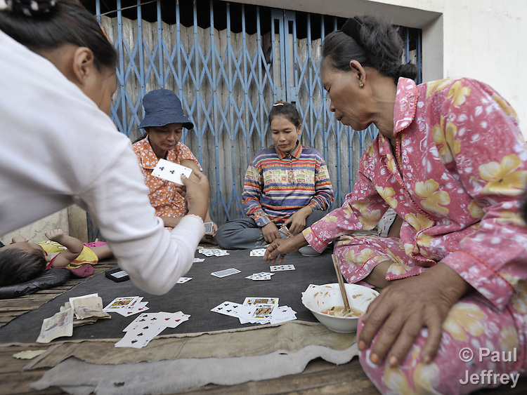 Women play cards in the Chamroen neighborhood of Phnom Penh, Cambodia.