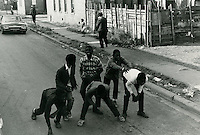 1966 October 27..Historical...Picture of boys playing football on Lavale Street..Sam McKay.NEG# SLM66-10-32.NRHA# 4319..