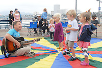 "Santa Monica Pier legend Michael Cladis sings to children at the Santa Monica Pier during ""Wake Up With The Waves"" on Saturday, September 17, 2011. The children's interactive concert series are held every Saturday morning at 9AM through October 29, 2011."