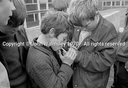 Boys smoking after school, Whitworth Comprehensive School, Whitworth, Lancashire.  1970.