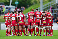 The Scarlets team huddle together prior to the second half. Pre-season friendly match, between the Scarlets and Bath Rugby on August 20, 2016 at Eirias Park in Colwyn Bay, Wales. Photo by: Patrick Khachfe / Onside Images