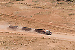 Roadtrains traversing the Birdsville Track.