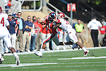 Ole Miss quarterback Randall Mackey (1) is chased by Arkansas safety Houston Pruitt (30) at Vaught-Hemingway Stadium in Oxford, Miss. on Saturday, October 22, 2011. .