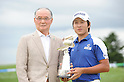 (L-R) Shigeo Nagashima,  Kyung-Tae Kim (KOR),JULY 24, 2011 - Golf :Kim Kyung-Tae of South Korea poses with the trophy and Shigeo Nagashima after winning the Nagashima Shigeo Invitational Sega Sammy Cup Golf Tournament at The North Country Golf Club in Chitose, Hokkaido, Japan. (Photo by Hitoshi Mochizuki/AFLO)