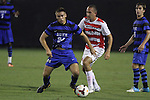 30 August 2013: Duke's Rob Dolot (24) and Rutger's Juan Pablo Correa (43). The Duke University Blue Devils hosted the Rutgers University Scarlet Knights at Koskinen Stadium in Durham, NC in a 2013 NCAA Division I Men's Soccer match. The game ended in a 1-1 tie after two overtimes.