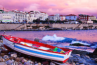 Sun sets over Alghero in Sardinia, Italy.