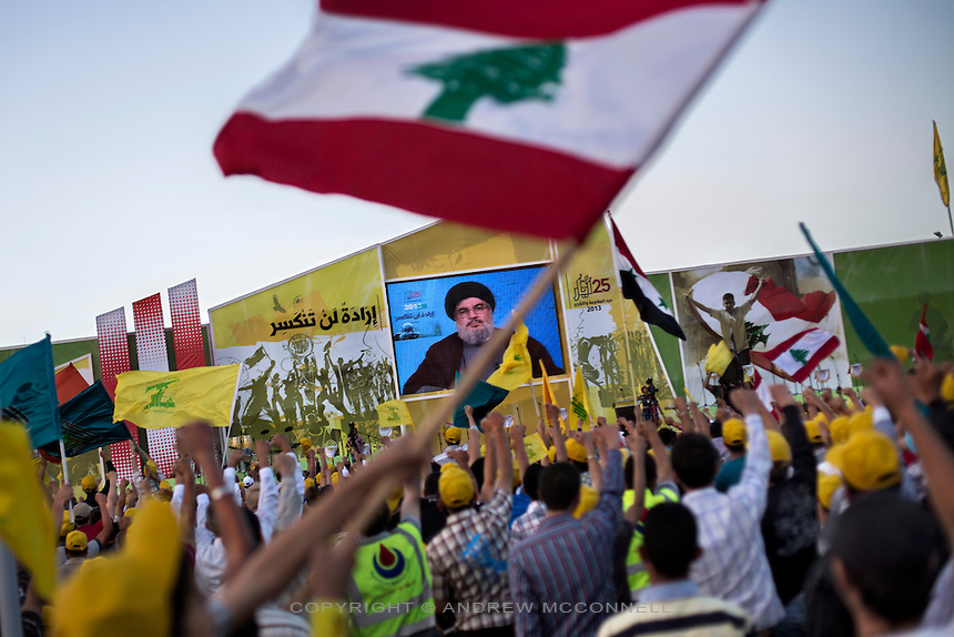 "Hezbollah leader Hassan Nasrallah delivers a speech through a video link to party supporters on the occasion of Liberation Day, the day Israel withdrew from south Lebanon in 2000, in Mashgara, Lebanon. In the speech Nasrallah confirmed for the first time that Hezbollah were actively fighting in Syria, saying, ""we will not rely on anyone ... like all the battles before this one: We will be its people, its men, and we will be the ones who bring it victory."""