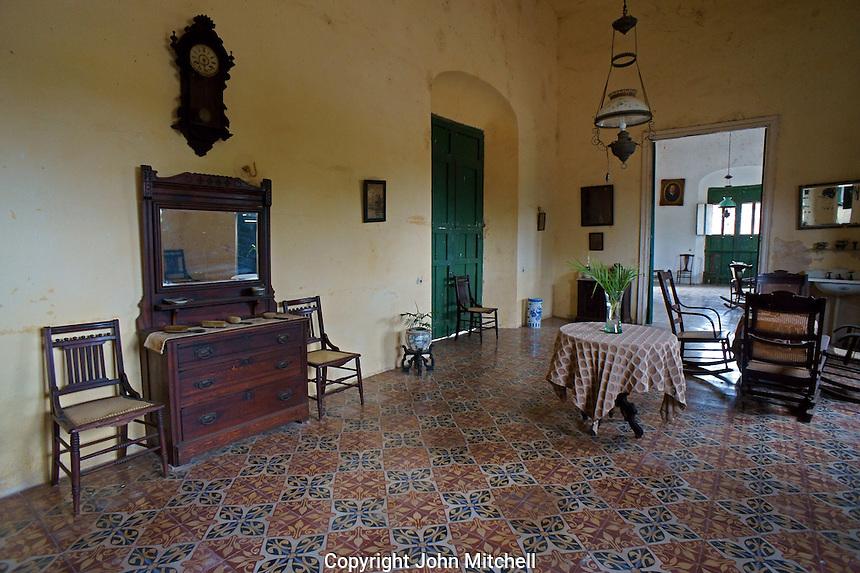 Interior room of main building with colonial antique furniture at Hacienda Yaxcopoil, Yucatan, Mexico.
