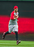 21 May 2014: Washington Nationals outfielder Bryce Harper takes some football practice for conditioning during the rehabilitation of his hand injury prior to a game between the Cincinnati Reds and the Washington Nationals at Nationals Park in Washington, DC. The Reds edged out the Nationals 2-1 to take the rubber match of their 3-game series. Mandatory Credit: Ed Wolfstein Photo *** RAW (NEF) Image File Available ***