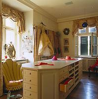A central storage unit dominates this feminine dressing room