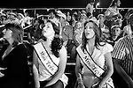 Miss Teen Texas and Mrs. Texas watch the rodeo action in Bastrop, Texas.  August 2, 2008.