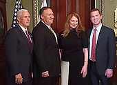 United States Representative Mike Pompeo (Republican of Kansas), second left, poses for a photo with his family prior to being sworn-in as Director of the Central Intelligence Agency (CIA) by US Vice President Mike Pence, left, in the Vice President's ceremonial Office at the White House in Washington, DC on Monday, January 23, 2017.  Pompeo was accompanied by his wife, Susan, second right, and his son, Nick, right.<br /> Credit: Ron Sachs / Pool via CNP