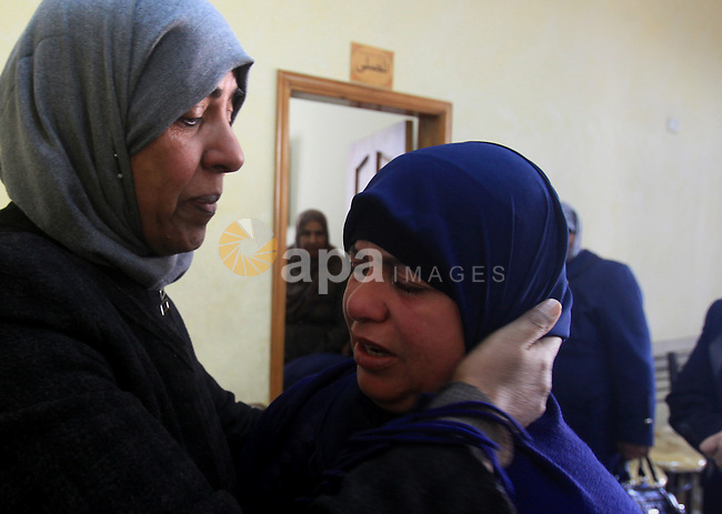 Raeda Eskafi Mother of Palestinian Omar Eskafi,21, who was shot dead after he allegedly injured two Israelis in a stabbing attack in central Jerusalem on Saturday night mourns in their house in Jerusalem on Dec. 07, 2015. At least 112 Palestinians have been killed by Israelis since the beginning of October. While Israel alleges many of those were attempting to attack Israelis when they were shot, Palestinians and rights groups have disputed Israel's version of events in a number of cases. Photo by Mahfouz Abu Turk