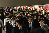 Businessmen in an underground passage in Shinjuku Station, Tokyo, Japan during morning rush-hour. With up to 4 million passengers passing through it every day, Shinjuku station, Tokyo, Japan, is the busiest train station in the world. The station was used by an average of 3.64 million people per day.  That&rsquo;s 1.3 billion a year.  Or a fifth of humanity. Shinjuku has 36 platforms, and connects 12 different subway and railway lines.  Morning rush hour is pandemonium with all trains 200% full. <br /> <br /> Photo by Richard jones / sinopix
