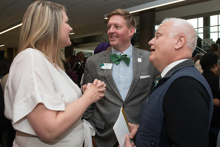 Time Binegar, center, Stacy Binegar, left, and J. Marcus Fultz greet one another following the ribbon cutting for the Gladys W. and David H. Patton College of Education's newly renovated McCracken Hall held on January 27, 2017.