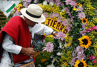 "MEDELLIN, COL AUG 07. A flower grower known as ""silleteros""  near floral arrangements  of an  flower 59th in Medellin,  Colombia, on August 7, 2016. (Photo by Fredy Builes / VIEWpress)"