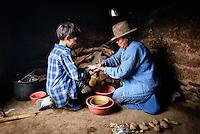 Victoria Cruz helps Luke make bunuelos - Bolivian donuts - in her kitchen in Maragua, in the Cordillera de los Frailes.