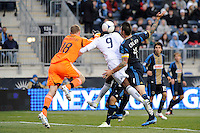 Atiba Harris (9) of the Vancouver Whitecaps collides with Philadelphia Union goalkeeper Zac MacMath (18). The Philadelphia Union and the Vancouver Whitecaps played to a 0-0 tie during a Major League Soccer (MLS) match at PPL Park in Chester, PA, on March 31, 2012.