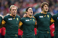 Schalk Burger, Francois Louw and Lodewyk De Jager of South Africa sing their national anthem. Rugby World Cup Pool B match between South Africa and the USA on October 7, 2015 at The Stadium, Queen Elizabeth Olympic Park in London, England. Photo by: Patrick Khachfe / Onside Images