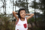 """Nguyen Thi Ly, 11, pauses while skipping rope in her village south of Da Nang, Vietnam. She is a third generation victim of dioxin exposure, the result of the U.S. military's use of Agent Orange and other herbicides during the Vietnam War more than 40 years ago. She suffers from facial deformities and chronic bone pain, but is otherwise a normal little girl with hopes and dreams for the future. """"I want to be a teacher in a primary school,"""" she says, shyly. """"She's very good at mathematics and literature,"""" adds her mother, Le Thi Thu, 42, who suffers from the same afflictions. """"She's very hard-working and industrious."""" The Vietnam Red Cross estimates that 3 million Vietnamese suffer from illnesses related to dioxin exposure, including at least 150,000 people born with severe birth defects since the end of the war. The U.S. government is paying to clean up dioxin-contaminated soil at the Da Nang airport, which served as a major U.S. base during the conflict. But the U.S. government still denies that dioxin is to blame for widespread health problems in Vietnam and has never provided any money specifically to help the country's Agent Orange victims. May 28, 2012."""