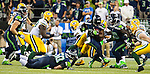 Seattle Seahawks running back Marshawn Lynch (24) rushes against the Green Bay Packers in the NFL Kickoff held at CenturyLink Field September 4, 2014 in Seattle.  Lynch rushed for 110 yards and scored two touchdown in the Seahawks 36-16 win over the Packers.   Seattle beat Green Bay 36-16. ©2014  Jim Bryant Photo. ALL RIGHTS RESERVED.