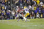 Ole Miss quarterback Bo Wallace (14) is chased by LSU defensive end Barkevious Mingo (49) at Tiger Stadium in Baton Rouge, La. on Saturday, November 17, 2012. LSU won 41-35.....