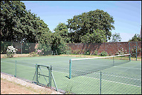 BNPS.co.uk (01202 558833)<br /> Pic: StruttandParker/BNPS<br /> <br /> ***Please Use Full Byline***<br /> <br /> FYI: The tennis court on the Eaglehurst estate, once the holiday home to Queen Victoria. <br /> <br /> <br /> A grand country estate which almost became Queen Victoria's summer house has gone on the market for a whopping 6.5 million pounds.<br /> <br /> The monarch fell in love with the enormous Eaglehurst estate when she stayed there as a 14-year-old in 1833.<br /> <br /> Four years later Victoria ascended the throne and, wanting somewhere to which she and her beloved husband Albert could retreat from the pressures of court life, began searching for a holiday residence. <br /> <br /> Her first thought was Eaglehurst. Albert was taken with the unbeatable views of the Solent, which he likened to the Bay of Naples, but the pair eventually settled on Osborne House almost directly opposite Eaglehurst on the Isle of Wight.<br /> <br /> The 10-acre estate dates back to the early 1800s when it was built by General Richard Lambart, a Napoleonic era military commander who was the governor of nearby Calshot Castle.<br /> <br /> Eaglehurst is now on the market with Strutt and Parker for 6.5 million pounds.