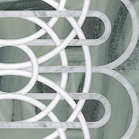 Overlapping Circles, a stone water jet mosaic, shown in Thassos, Carrara, and Kay's Green, is part of the Ann Sacks Beau Monde collection sold exclusively at www.annsacks.com