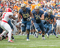 Pitt offensive linemen Dorian Johnson (53) and Gabe Roberts (71) block for runnning back James Conner (24).The Pitt Panthers football team defeated the Youngstown State Penguins 45-37 on Saturday, September 5, 2015 at Heinz Field, Pittsburgh, Pennsylvania.