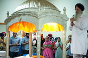 Attendees pray during the gathering at the Sikh Gurudwara of North Carolina in Durham to honor the victims of the Oak Creek shooting on Wednesday August 8th 2012.
