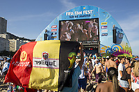 Belgium fans with a flag watch the big screen at the FIFA Fan Fest on Copacabana beach in Rio de Janeiro