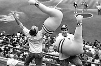 """Two Oakland Athletics fans imitate the """"Bash Bros."""" at the A's vs. San Francisco Giants World Series opener in Oakland. (1989 photo by Ron Riesterer)"""
