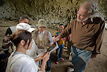 Mike Morwood interprets for Japanese tourists visiting Liang Bua cave, discovery site of the Flores hobbit (Homo floresiensis).
