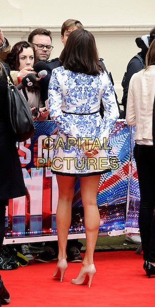 Alesha Dixon.attends the Britain's Got Talent launch, at The ICA, London, England, UK, 11th April 2013..full length blue and white print shirt dress hands back rear behind  long sleeve .CAP/DH.©David Hitchens/Capital Pictures