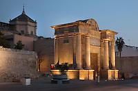 Puerta del Puente, or Gate of the Bridge, built in Renaissance style with Doric columns and classical entablature by Hernan Ruiz III in 1572 to link the city to the Roman bridge, in Cordoba, Andalusia, Southern Spain. Behind is the facade of the Great Mosque of Cordoba, now part of the Cathedral. The first church built here by the Visigoths in the 7th century was split in half by the Moors, becoming half church, half mosque. In 784, the Great Mosque of Cordoba was built in its place, but in 1236 it was converted into a catholic church, with a Renaissance cathedral nave built in the 16th century. The historic centre of Cordoba is listed as a UNESCO World Heritage Site. Picture by Manuel Cohen