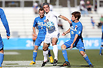 14 December 2014: Virginia's Patrick Foss (20) is defended by UCLA's Brian Iloski (18) and Felix Vobejda (GER) (7). The University of Virginia Cavaliers played the University of California Los Angeles Bruins at WakeMed Stadium in Cary, North Carolina in the 2014 NCAA Division I Men's College Cup championship match. Virginia won the championship by winning the penalty kick shootout 4-2 after the game ended in a 0-0 tie after overtime.
