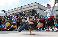 September 18, 2011 - Juan Benitz (right) and Chris Phan (left) of the Orphanage Krew, pump up the crowd at stART on the Street. (Matt Wright/Worcester Telegram & Gazette)