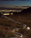 The single, long-exposure image is part of Trail 8A in the Phoenix Mountain Preserve near the intersection of Lincoln Drive and 32nd Street at sunset on February 14, 2012, the centennial anniversary of statehood for Arizona.  I made the painted trail of light along this section of Trail 8A and also stopped at a large white granite boulder that is a landmark of the trail to record my shadow.