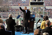 Washington, DC - January 20, 2009 -- United States President Barack Obama waves to the crowd just after he was sworn-in as the 44th President of the United States and the first African-American to lead the nation at the Capitol in Washington Tuesday, January 20, 2009. Former President George W. Bush stands and applauds at left. .Credit: J. Scott Applewhite - Pool via CNP