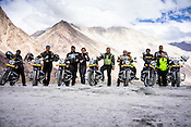 Bikers pose for a photograph on their Royal Enfield 500CC motorcycles in Nurba Valley in Ladakh, India.