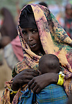 After trekking across east Africa, a Somali woman waits with her child to be registered in the Dadaab refugee camp in northeastern Kenya. Tens of thousands of newly arrived Somalis have swelled the population of what was already the world's largest refugee camp.