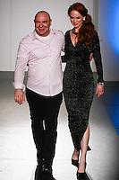 Fashion designer Danilo Gabrielli walks runway at the close of his Danilo Gabrielli Fall Winter 2012 collection with model Ashley Vasicek, during Nolcha Fashion Week: New York February 2012.