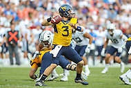 Landover, MD - September 23, 2016: West Virginia Mountaineers quarterback Skyler Howard (3) attempts a pass during game between BYU and WVA at  FedEx Field in Landover, MD.  (Photo by Elliott Brown/Media Images International)